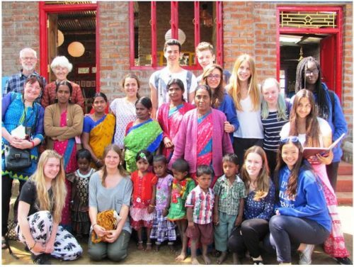 Ecolint staff and students with children and staff of Little Lilies Crèche.