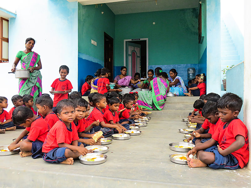 Lunch at Good Shepherd Preschool: It's difficult for very poor parents to provide adequate food for their growing children. Crèche meals are planned to provide all their nutritional needs.