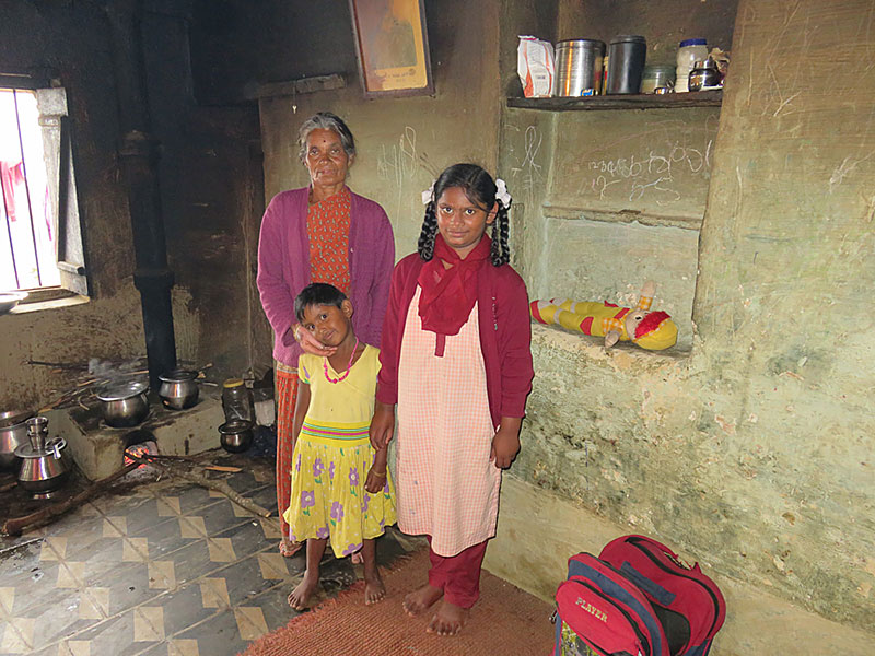 Two sisters, one a current crèche student and the other in primary school, live with their grandmother. Their mother died and the father has abandoned them. Their grandmother supports them all by coolie work, collecting and carrying bundles of firewood from a distance. Their home is this one small room.