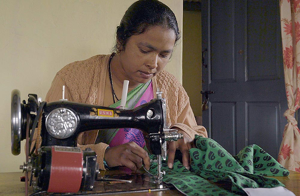 Mumtaz, the director of the sewing center, works on one of three sewing machines.