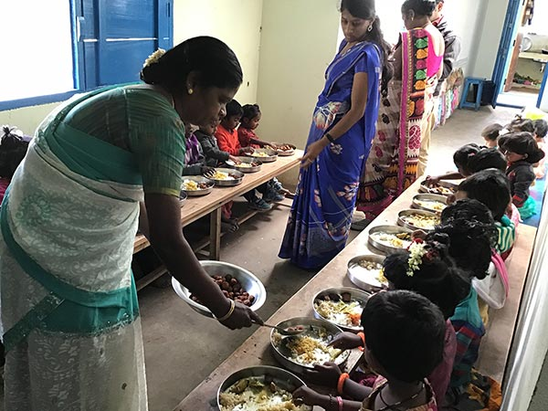 Lunch, the main meal of the day, is cooked fresh at the school. Teachers serve the children.