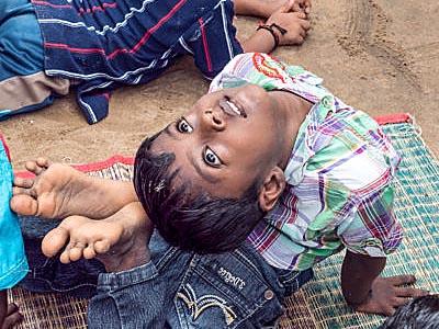 Help Kids India - little boy doing yoga