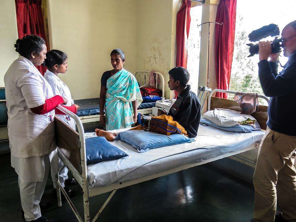 Videographer Tom Kidder films student nurses Anitha and Malliga, both former crèche children.